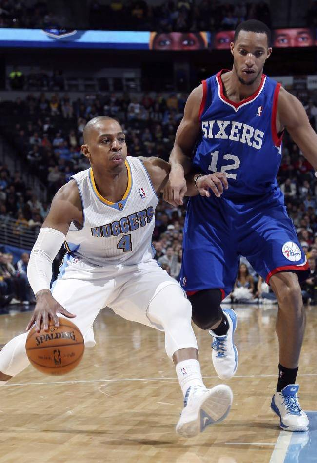 Denver Nuggets guard Randy Foye, left, works the ball inside for a shot as Philadelphia 76ers forward Evan Turner covers in the third quarter of the Sixers' 114-102 victory in an NBA basketball game in Denver on Wednesday, Jan. 1, 2014