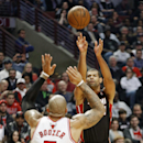 Miami Heat forward Shane Battier, right, shoots over Chicago Bulls forward Carlos Boozer, left, during the first half of an NBA basketball game in Chicago, Thursday, Dec. 5, 2013 The Associated Press