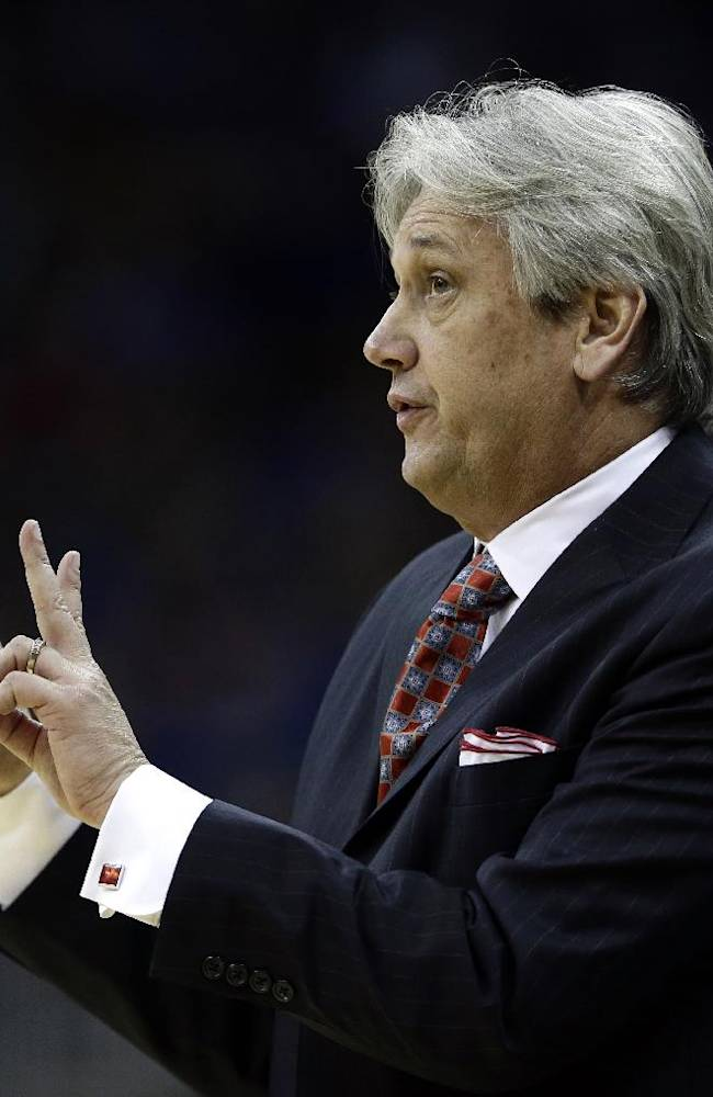 New Mexico coach Craig Neal motions to his players during the first half of an NCAA college basketball game against Kansas, Saturday, Dec. 14, 2013, in Kansas City, Mo