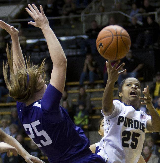Purdue's April Wilson, right,throws up a shot as Northwestern's Maggie Lyon defends during an NCAA college basketball game Thursday, Jan. 23, 2014, in West Lafayette, Ind. Purdue won 90-65
