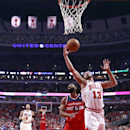 Chicago Bulls center Joakim Noah (13) grabs a rebound over Washington Wizards forward Nene Hilario (42) during the first half of Game 2 in an opening-round NBA basketball playoff series Tuesday, April 22, 2014, in Chicago The Associated Press