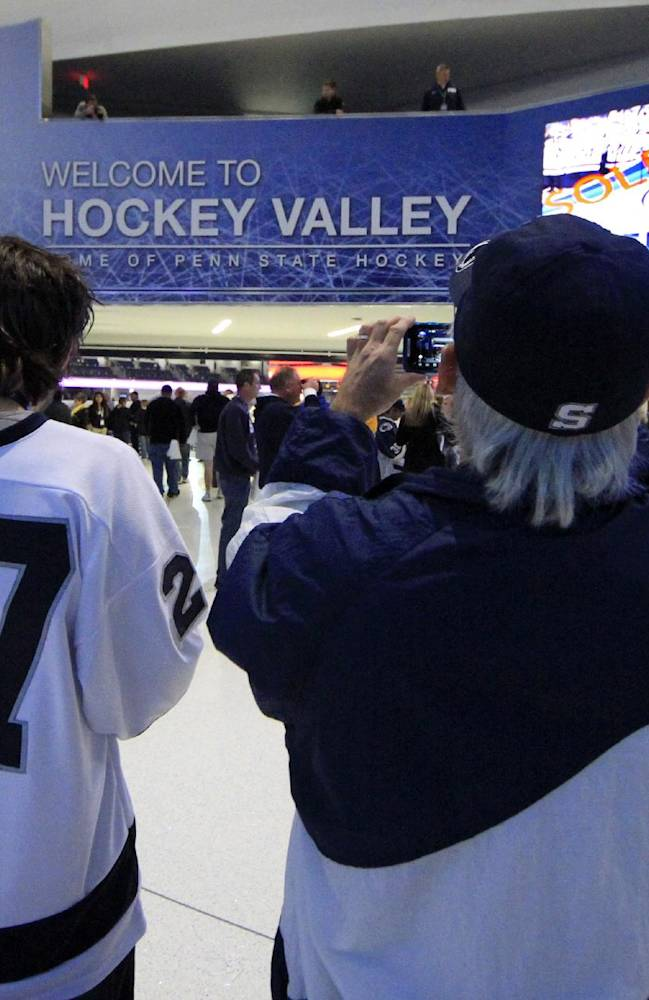 A Penn State hockey fan take photos in the lobby of the Pegula Ice Arena before a college hockey game between Army and Penn State in State College, Pa., Friday, Oct. 11, 2013. The game will be the first in the new arena