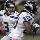 Seattle Seahawks quarterback Russell Wilson, left, hands off to running back Marshawn Lynch during the first quarter of an NFL football game against the St. Louis Rams, Sunday, Oct. 19, 2014, in St. Louis The Associated Press