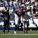San Diego Chargers tight end Antonio Gates hauls in a pass under pressure from New York Jets strong safety Dawan Landry during the second half of an NFL football game, Sunday, Oct. 5, 2014, in San Diego The Associated Press