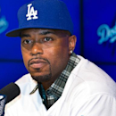 Dodgers newly acquired infielder Jimmy Rollins is introduced at Dodger Stadium in Los Angeles Wednesday, Jan. 7, 2015. Jimmy Rollins waived his no-trade clause after 14 years in Philadelphia to join the Los Angeles Dodgers, where the 36-year-old will repl