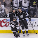 Los Angeles Kings forward Jeff Carter (77), celebrates with his teammates Tanner Pearson (70) and Tyler Toffoli (73) after scoring during the third period of an NHL hockey game against the Phoenix Coyotes, Wednesday, April 2, 2014, in Los Angeles. The Kin