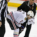 Chicago Blackhawks' Brent Seabrook is helped off the ice after receiving a cut to his face in the third period of an NHL hockey game against the Minnesota Wild, Thursday, Jan. 8, 2015, in St. Paul, Minn. The Blackhawks won 4-2 The Associated Press