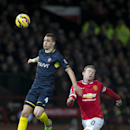Southampton's Morgan Schneiderlin, left, keeps the ball from Manchester United's Wayne Rooney during the English Premier League soccer match between Manchester United and Southampton at Old Trafford Stadium, Manchester, England, Sunday Jan. 11, 2015. (AP