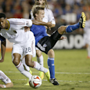 San Jose Earthquakes midfielder Tommy Thompson, right, is tripped up by Real Salt Lake defender Chris Schuler (28) during the second half of an MLS soccer match Saturday, Aug. 30, 2014, in Santa Clara, Calif. The game ended in a 1-1 tie The Associated Pre