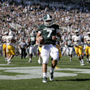 Michigan State quarterback Tyler O'Connor (7) scores a touchdown on a 12-yard keeper against Wyoming during the fourth quarter of an NCAA college football game, Saturday, Sept. 27, 2014, in East Lansing, Mich. Michigan State won 56-14. (AP Photo/Al Goldis)