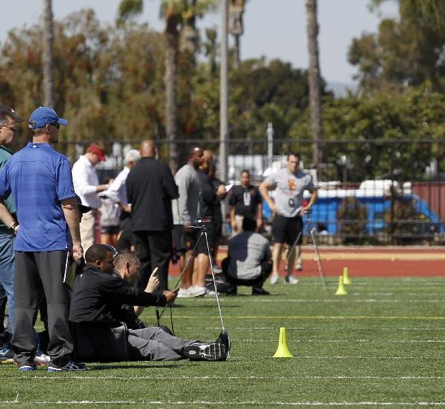 Offensive lineman Abe Markowitz, right, sprints during Southern California pro day for NFL scouts at Loker Field on Wednesday, March 12, 2014, in Los Angeles