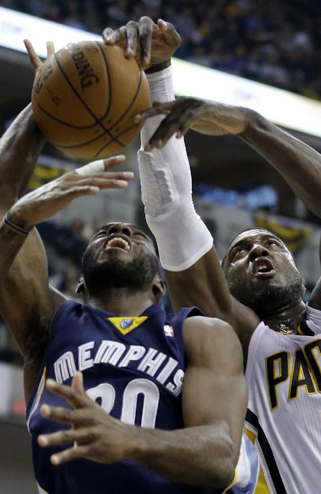 Indiana Pacers center Roy Hibbert, right, blocks the shot of Memphis Grizzlies forward Quincy Pondexter in the first half of an NBA basketball game in Indianapolis, Monday, Nov. 11, 2013