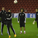 Real Madrid's Marcelo, center, smiles as he trains with teammates at Anfield Stadium, in Liverpool, England, Tuesday, Oct. 21, 2014. Real Madrid will play Liverpool in a Champion's League Group B soccer match on Wednesday