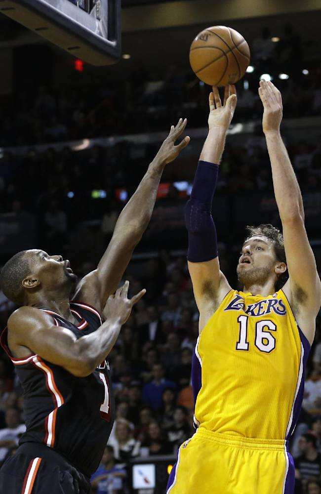 Los Angeles Lakers center Pau Gasol (16) shoots over Miami Heat center Chris Bosh (1)  during the fourth quarter of an NBA basketball game in Miami, Thursday, Jan. 23, 2014. The Heat won 109-102