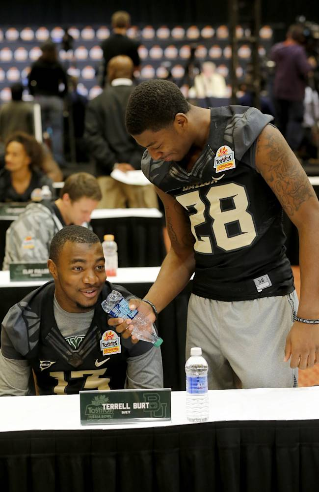 Baylor safety Terrell Burt pretends to be interviews by teammate Orion Stewart (28) during the Fiesta Bowl media Day, Monday, Dec. 30, 2013, in Scottsdale, Ariz. Baylor will face Central Florida on Jan. 1, 2014 in the Fiesta Bowl NCAA college football game