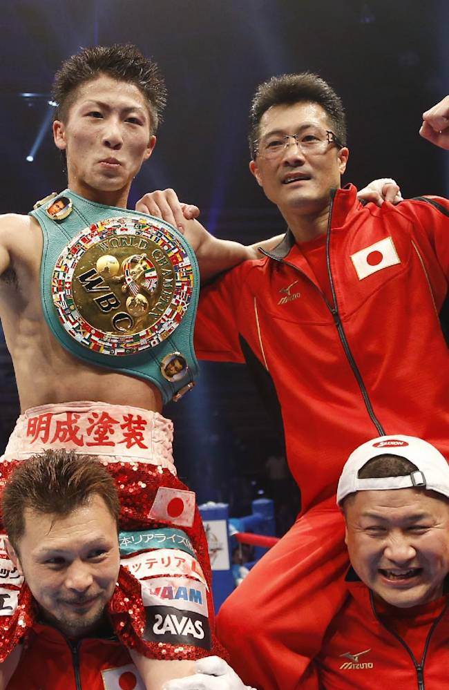 Naoya Inouye of Japan, top left, celebrates after he won against Adrian Hernandez of Mexico during their WBC light flyweight title bout in Tokyo, Sunday, April 6, 2014