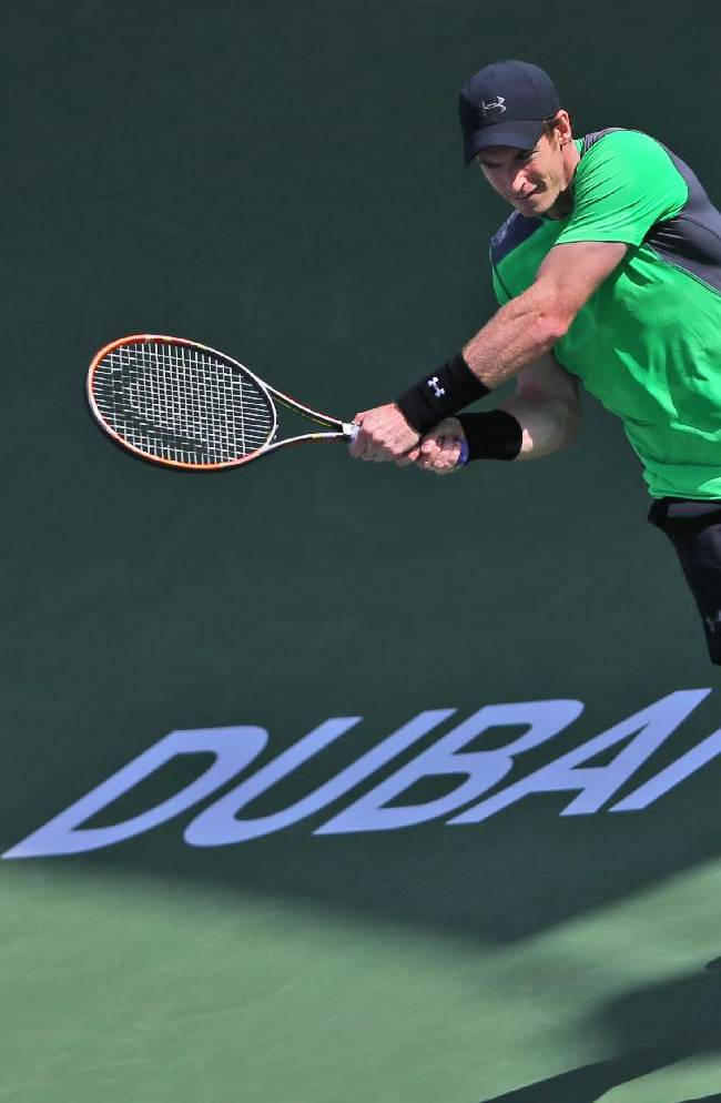 Federer rallies to reach Dubai quarters, Djokovic through