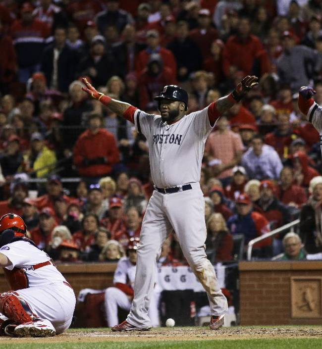 St. Louis Cardinals catcher Yadier Molina looks back as Boston Red Sox designated hitter David Ortiz, left, celebrates with Dustin Pedroia after scoring on a sacrifice fly by Stephen Drew during the fifth inning of Game 4 of baseball's World Series against the St. Louis Cardinals Sunday, Oct. 27, 2013, in St. Louis