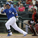 Kansas City Royals' Billy Butler follows through on a single to left off Cincinnati Reds' Robert Stephenson as catcher Devin Mesoraco watches in the fifth inning of a spring training baseball game, Tuesday, March 4, 2014, in Surprise, Ariz The Associated