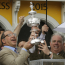 FILE - In this May 16, 2015 file photo, American Pharoah owner Ahmed Zayat, left, and Maryland Gov. Larry Hogan hold the Woodlawn Vase after American Pharoah with Victor Espinoza aboard won the 140th Preakness Stakes horse race at Pimlico Race Course, in Baltimore. Zayat is fighting a lawsuit that accuses him of owing $1.65 million to a man who says he fronted him money for gambling bets placed at offshore casinos. (AP Photo/Matt Slocum, File)