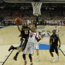 Wichita State's Tekele Cotton (32) heads to the hoop under the defense of Louisville's Gorgui Dieng (10) during the second half of the NCAA Final Four tournament college basketball semifinal game Saturday, April 6, 2013, in Atlanta. (AP Photo/NCAA Photos, Chris Steppig)