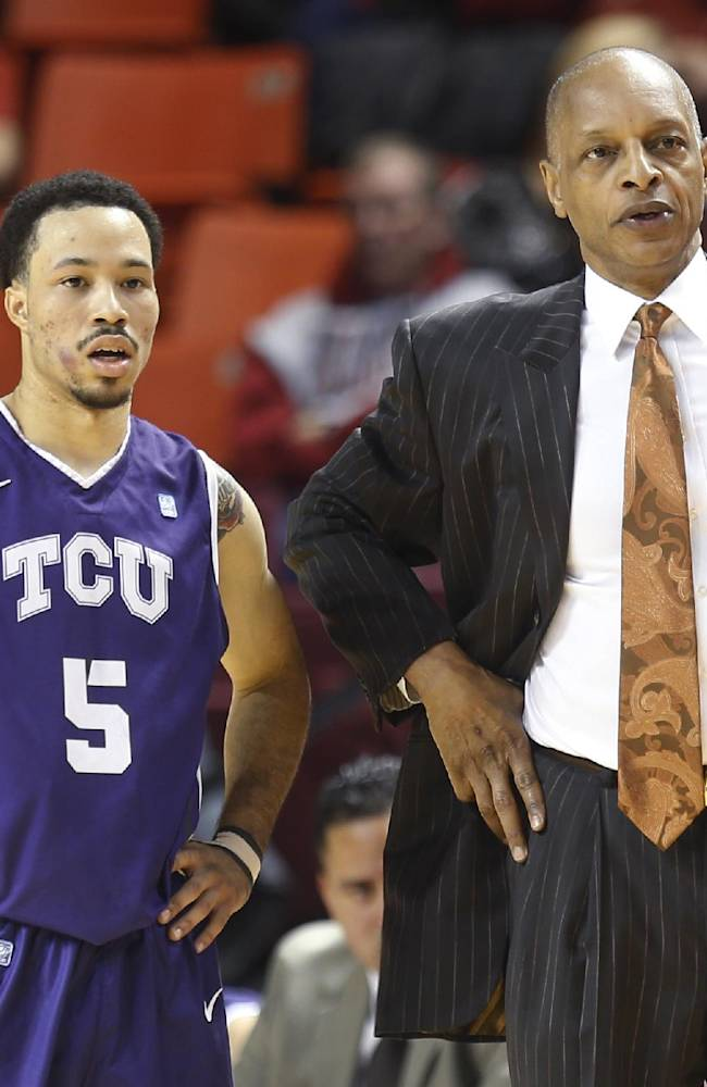 TCU coach Trent Johnson talks with guard Kyan Anderson (5) in the first half of an NCAA college basketball game against Oklahoma in Norman, Okla., Wednesday, Jan. 22, 2014. Oklahoma won 77-69