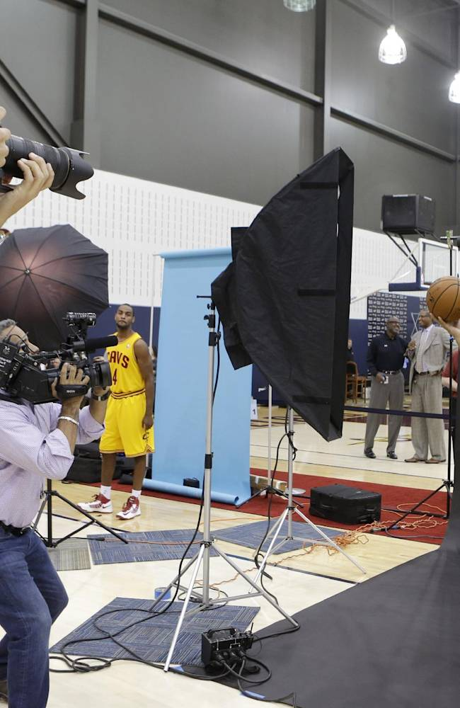 Cleveland Cavaliers' Anderson Varejao, from Brazil, poses for a photograph during the NBA teams media day Monday, Sept. 30, 2013, in Independence, Ohio