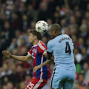 Bayern's Thomas Mueller, left, and Manchester City's Vincent Kompany head for the ball during the Champions League Group E soccer match between FC Bayern Munich and Manchester City at Allianz Arena in Munich, southern Germany, Wednesday Sept. 17, 2014