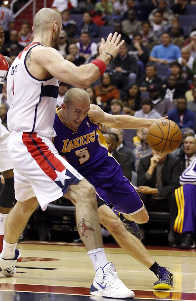 Los Angeles Lakers guard Steve Blake (5) runs into Washington Wizards center Marcin Gortat (4), from Poland, in the first half of an NBA basketball game Tuesday, Nov. 26, 2013, in Washington
