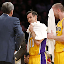 Los Angeles Lakers' Steve Nash, center, looks at coach Mike D'Antoni, left, as Steve Blake, right, wipes his face with a towel as the officials review a call at the end of the first half of an NBA basketball game in Los Angeles, Tuesday, Feb. 11, 2014 The
