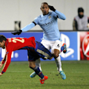 CSKA's Georgi Milanov, left, and Manchester City's Fernando, right, challenge for the ball during the Group E Champions League soccer match between CSKA Moscow and Manchester City at Arena Khimki stadium in Moscow, Russia, Tuesday, Oct. 21, 2014