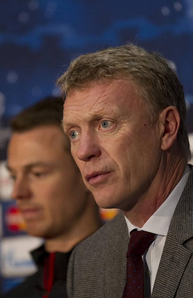 Manchester United's manager David Moyes, right, sits alongside Jonny Evans during a press conference at Old Trafford Stadium, Manchester, England, Tuesday, Oct. 22, 2013. Manchester United will play Real Sociedad in a Champion's League Group A soccer match on Wednesday