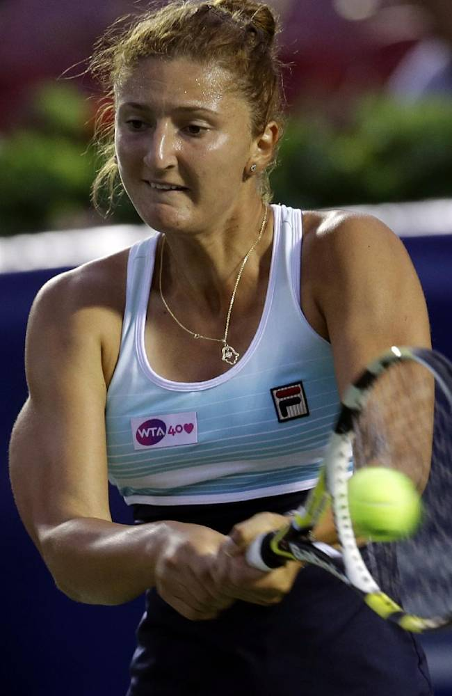 Irina-Camelia Begu of Romania returns a shot against Anastasia Pavlyuchenkova of Russia during the quarterfinal match of the Korea Open tennis championships in Seoul, South Korea, Friday, Sept. 20, 2013