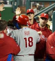 Philadelphia Phillies' Darin Ruf (18) is congratulated by teammates after hitting a home run during the fourth inning of a baseball game against the Washington Nationals in Washington, Tuesday, Oct. 2, 2012. (AP Photo/Manuel Balce Ceneta)