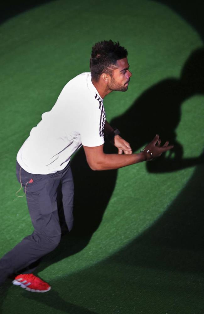 Indian cricket player Virat Kohli tosses a ball at the audience during a promotional event for Adidas in New Delhi, India, Thursday, Oct. 3, 2013. The German sportswear brand has roped in Kohli as its brand ambassador