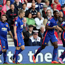 Manchester United's Juan Mata, left, celebrates his goal with his teammates during their English Premier League soccer match against Sunderland at the Stadium of Light, Sunderland, England, Sunday, Aug. 24, 2014