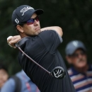 Adam Scott of Australia tees off on the ninth hole during the second round of the WGC-HSBC Champions golf tournament in Shanghai November 7, 2014. REUTERS/Aly Song