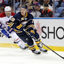 Buffalo Sabres' Zemgus Girgensons (28), of Latvia, carries the puck along the boards against Montreal Canadiens' Max Pacioretty (67) during the second period of an NHL hockey game Wednesday, Nov. 5, 2014, in Buffalo, N.Y. Montreal defeated Buffalo 2-1 iin