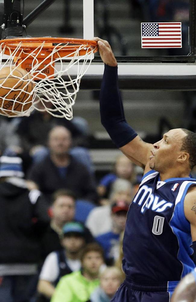 Dallas Mavericks' Shawn Marion slams in two points in the first quarter of an NBA basketball game against the Minnesota Timberwolves, Monday, Dec. 30, 2013, in Minneapolis