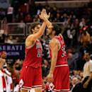 WASHINGTON, DC - DECEMBER 23: Pau Gasol #16 and Joakim Noah #13 of the Chicago Bulls celebrate following the Bulls 99-91 win over the Washington Wizards at Verizon Center on December 23, 2014 in Washington, DC. NOTE TO USER: User expressly acknowledges and agrees that, by downloading and or using this photograph, User is consenting to the terms and conditions of the Getty Images License Agreement.  (Photo by Rob Carr/Getty Images)