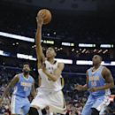 New Orleans Pelicans power forward Anthony Davis (23) goes to the basket in overtime in an NBA basketball game in New Orleans, Sunday, March 9, 2014. The Pelicans defeated the Nuggets 111-107. Looking on are Denver Nuggets power forward Darrell Arthur (00