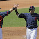 Cleveland Indians' Jason Kipnis (22) and Carlos Santana celebrate after scoring on a triple by Michael Brantley in the first inning of a spring exhibition baseball game against the Milwaukee Brewers Wednesday, March 26, 2014, in Goodyear, Ariz The Associa