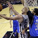 San Antonio Spurs' Manu Ginobili (20), of Argentina, is defended by Dallas Mavericks' Brandan Wright (34) as he tries to score during the second half of an NBA basketball game, Sunday, March 2, 2014, in San Antonio The Associated Press