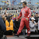 Juan Pablo Montoya, of Colombia, greets with fans during drivers introduction before the NASCAR Sprint Cup series auto race at Chicagoland Speedway in Joliet, Ill., Sunday, Sept. 15, 2013. (AP Photo/Nam Y. Huh)