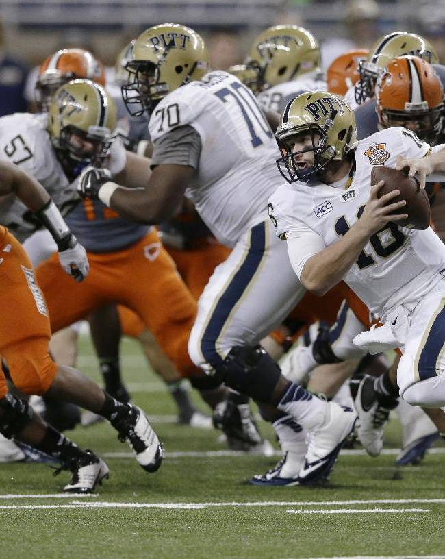 Pittsburgh quarterback Chad Voytik (16) scrambles during the second half of the Little Caesars Pizza Bowl NCAA college football game against Bowling Green, Thursday, Dec. 26, 2013, in Detroit. Pittsburgh won 30-27