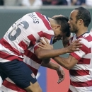 United States' Chris Wondolowski, back left, is congratulated by teammates Jose Torres, left, and Landon Donovan after scoring a goal during the first half of a CONCACAF Gold Cup soccer game against Belize in Portland, Ore., Tuesday, July 9, 2013. (AP Photo/Don Ryan)