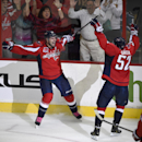 Washington Capitals right wing Troy Brouwer (20) celebrates his goal with Mike Green (52) during the third period of an NHL hockey game against the San Jose Sharks, Tuesday, Oct. 14, 2014, in Washington. The Sharks won 6-5 in a shootout The Associated Pre
