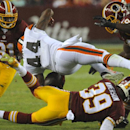 Cleveland Browns running back Ben Tate (44) is hit by Washington Redskins free safety David Amerson (39), with strong safety Brandon Meriweather (31) and Washington Redskins outside linebacker Brian Orakpo, right, nearby during the first half of an NFL pr