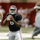 Alabama quarterback Blake Sims (6) works through passing drills during Alabama football practice, Tuesday, August 26, 2014, at the Hank Crisp Indoor Facility in Tuscaloosa, Ala The Associated Press