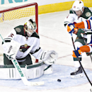 Minnesota Wild's goalie Darcy Kuemper (35) makes the save on Edmonton Oilers' Sam Gagner (89) as Ryan Suter (20) tries to defend during third period NHL hockey action in Edmonton, Alberta, on Thursday Feb. 27, 2014 The Associated Press